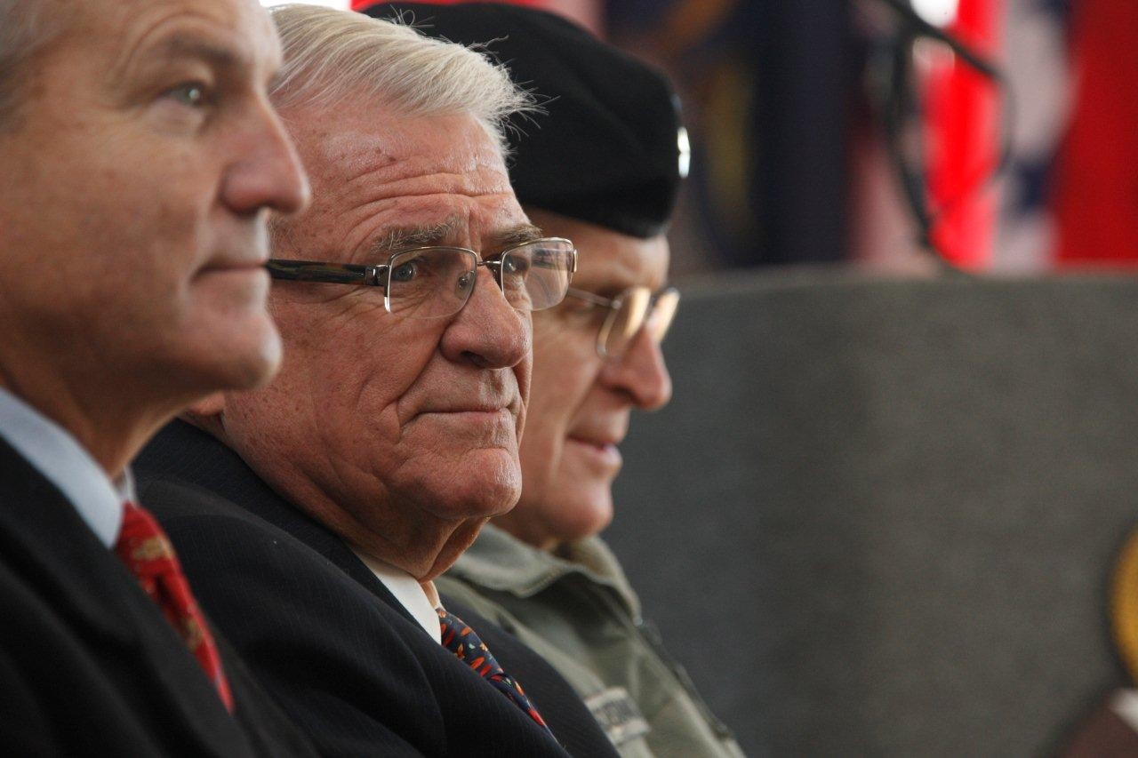 Congressmen Chet Edwards (left), John Carter (center) and Lt. Gen. Eric B. Schoomaker await their turn to address a Fort Hood crowd at the groundbreaking for the new Carl R. Darnall Army Medical Center, Dec. 13, 2010.