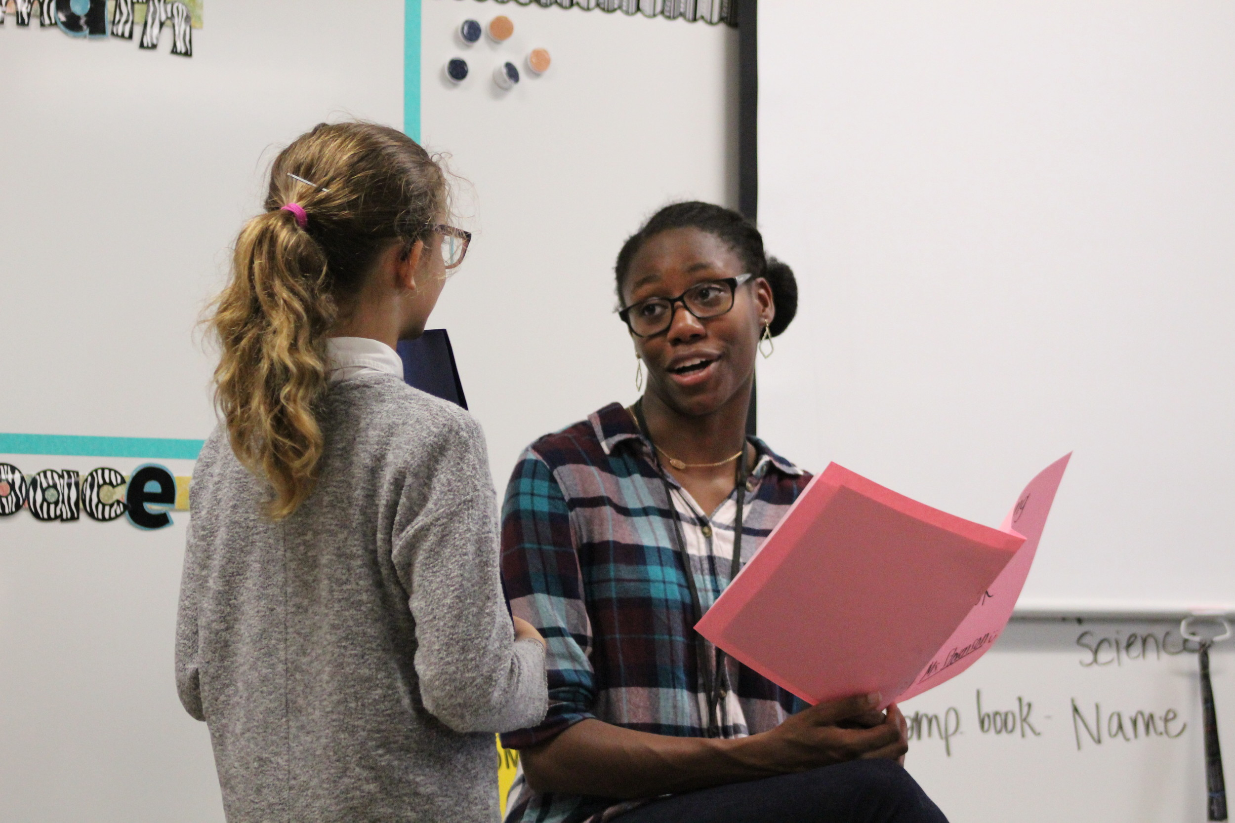 Khione Stevenson, right, talks with one of her students in her 5th grade math class on the first day of school at Rutledge Elementary School, Aug. 28.