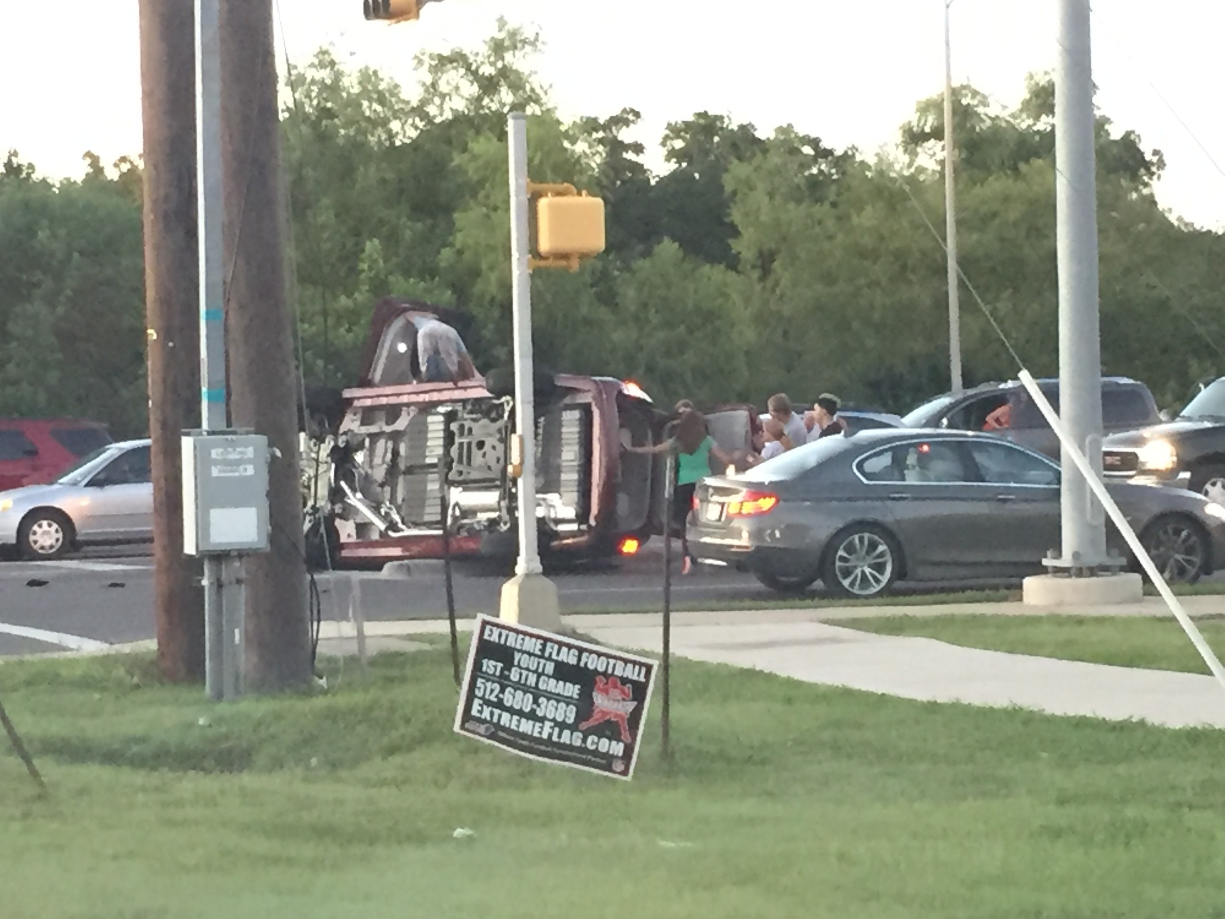 A burgundy Dodge van sits on its side following a traffic accident that caused it to flip at the intersection of Cypress Creek and Bell Blvd. in Cedar Park, Wednesday, Sept. 6.