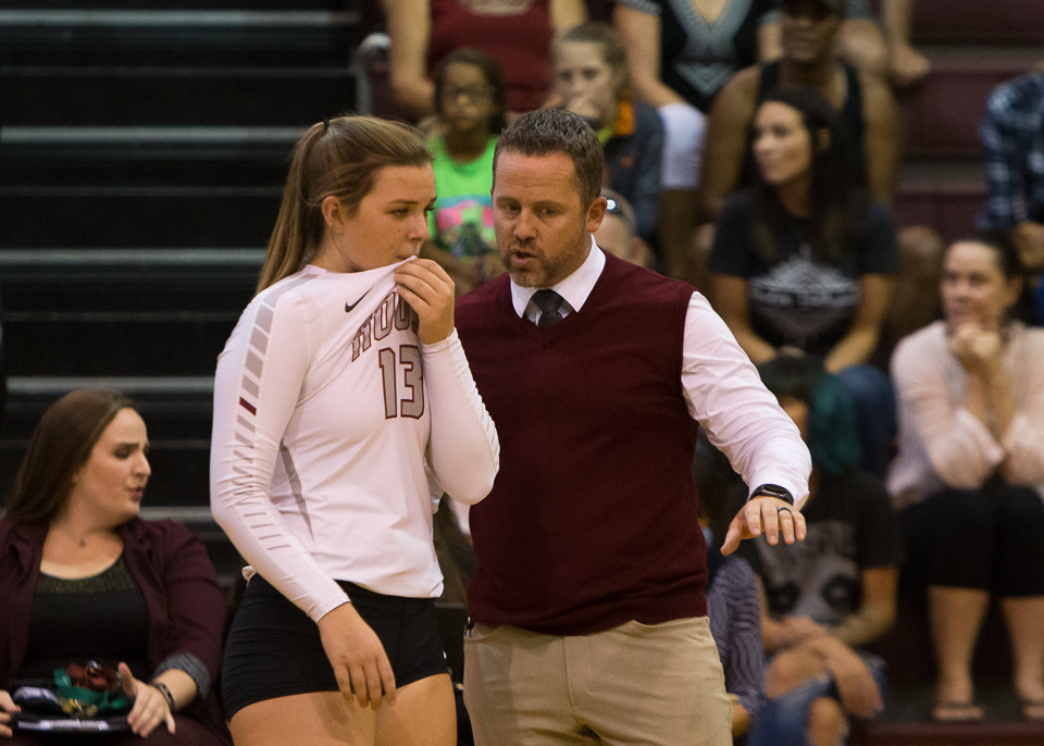 Rouse head coach Jacob Thompson talks with senior setter Maddie Sheehan (13). The Lady Raiders held onto their No. 1 ranking in the Texas Girls Coaches Association poll this week.