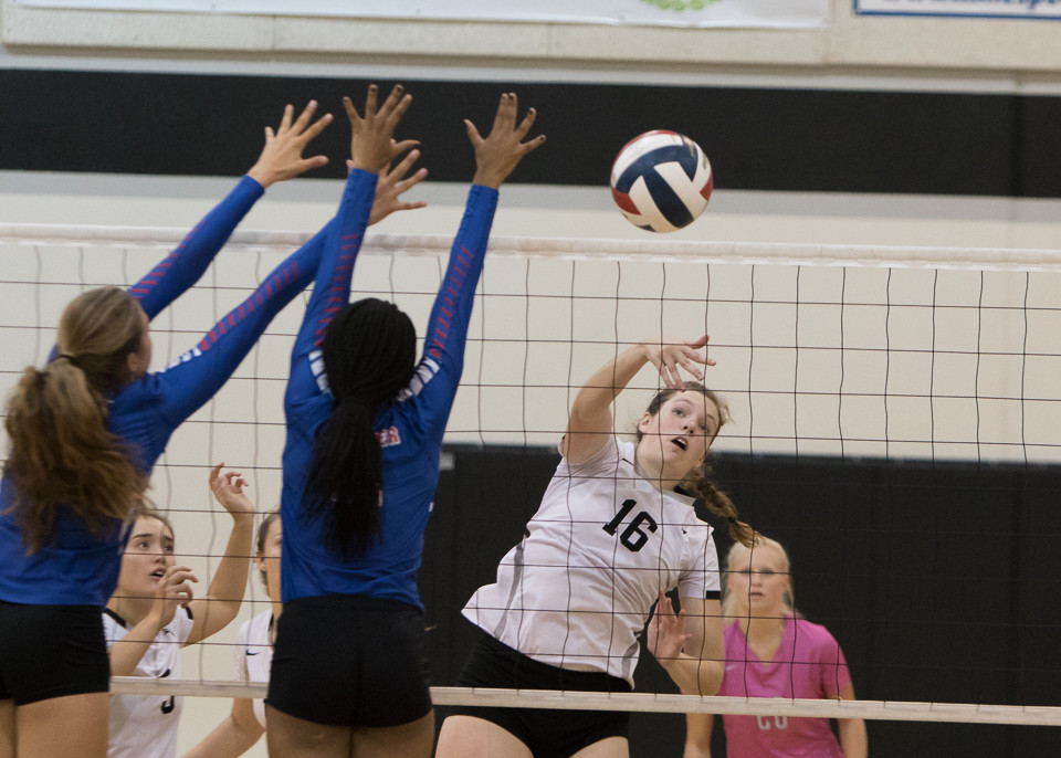 Vandegrift Vipers senior middle blocker Claudia Morris (16) in action during a high school volleyball game between the Vandegrift Vipers and the Leander Lions at Vandegrift High School in Austin, Texas, on September 19, 2017.
