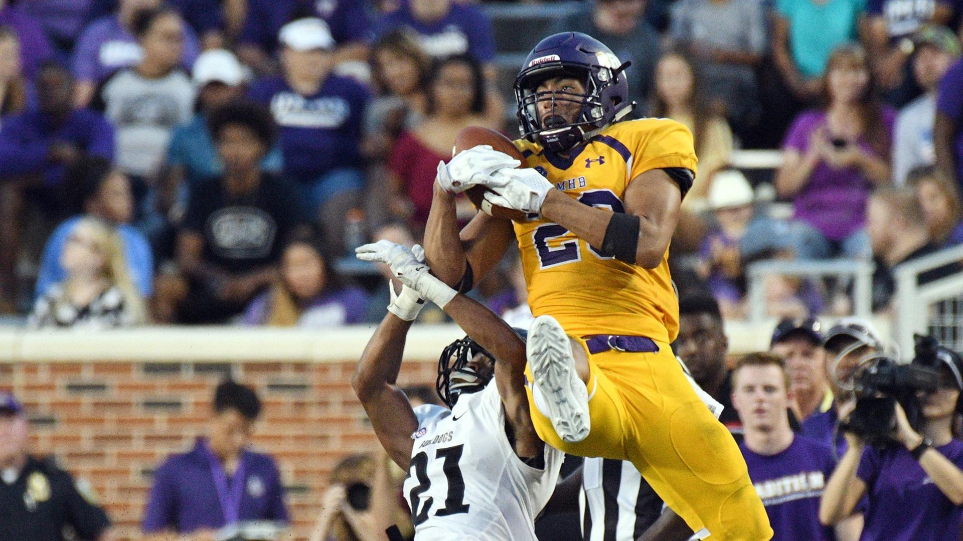UMHB sophomore wide receiver Jonel Reed brings in a catch during Saturday's 50-7 win over Texas Lutheran.
