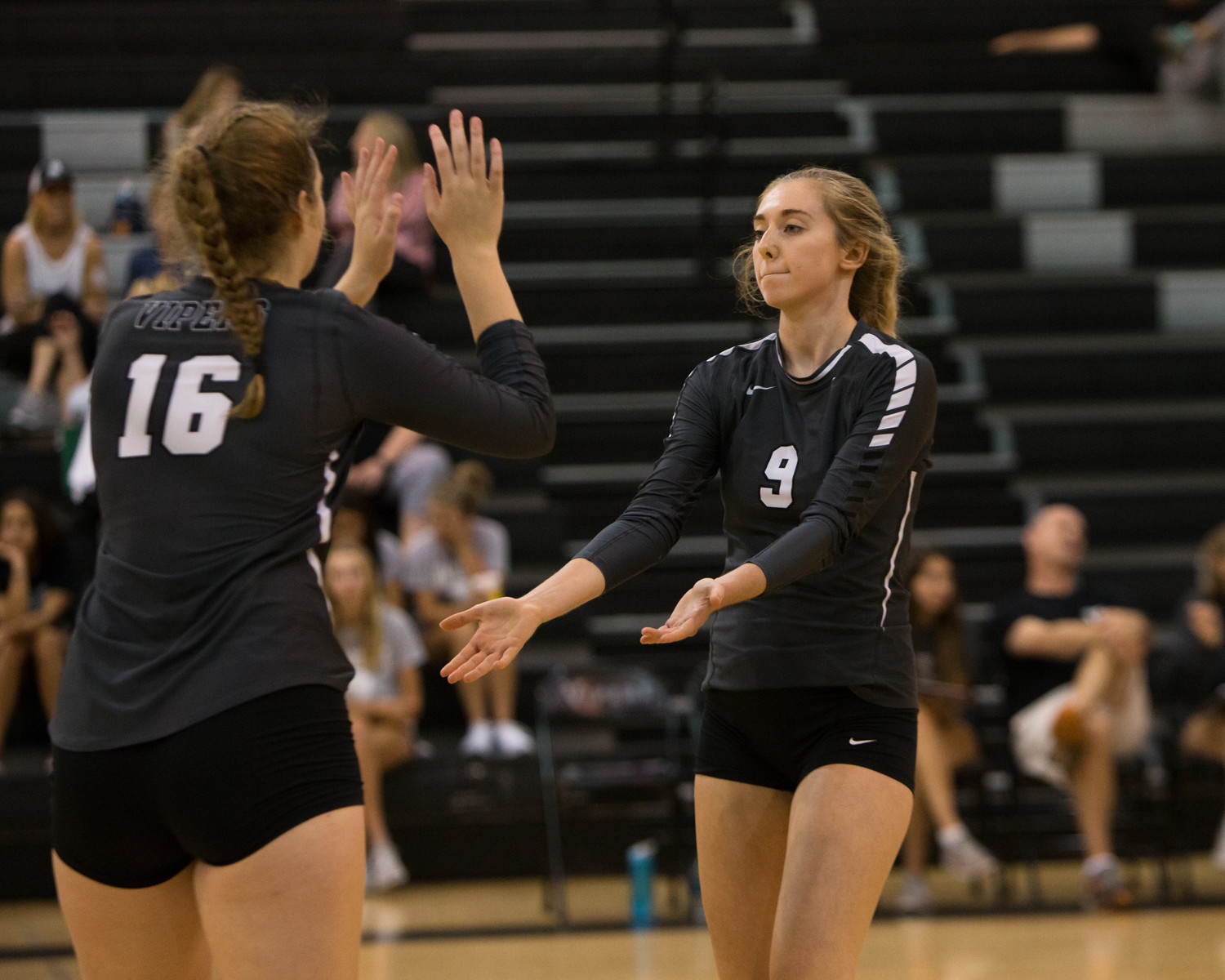 Vandegrift Vipers senior middle blocker Claudia Morris (16) and senior outside hitter Caroline Gehring (9) in action during Leander ISD's annual Volleypalooza tournament at Vandegrift High School in Austin, Texas, on Thursday, August 24, 2017.