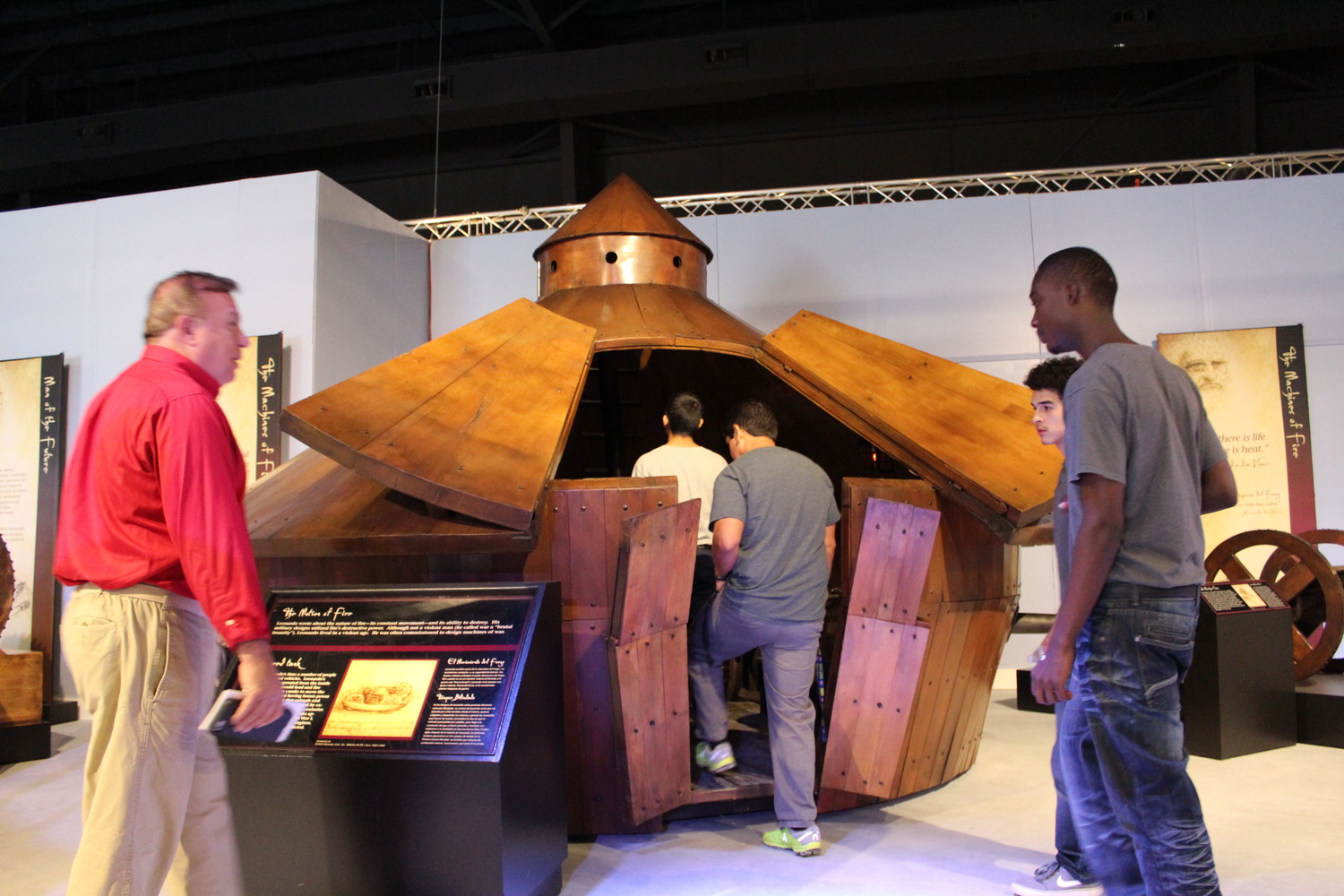 "Patrons of the Texas Museum of Science and Technology enter the life-size model of Leonardo Da Vinci's tank concept. The exhibit, ""Leonardo Da Vinci's Machines in Motion"" will be available for viewing through January 2018."