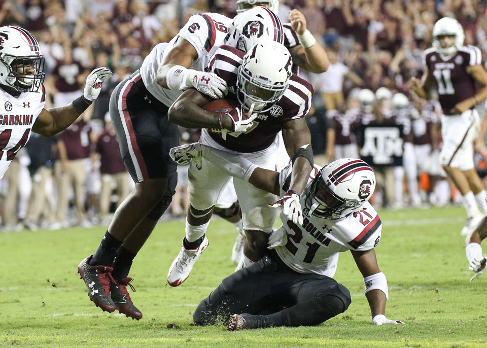 Texas A&M Aggies running back Keith Ford (7) dives across the goal line at the end of a 17-yard game-winning touchdown run during the fourth quarter of the NCAA football game between the Texas A&M Aggies and the South Carolina Gamecocks at Kyle Field in College Station, Texas. The Aggies won 24-17.