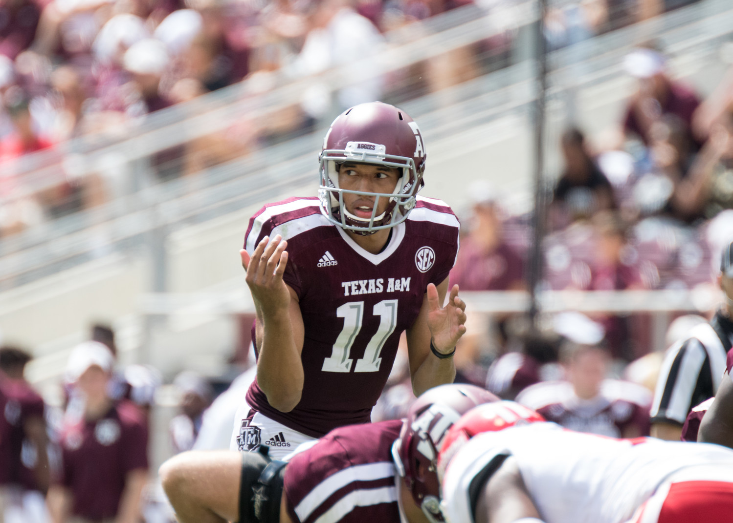 Texas A&M Aggies quarterback Kellen Mond (11) at the line of scrimmage during the game between the Texas A&M Aggies and the Louisiana-Lafayette Ragin' Cajuns at Kyle Field in College Station, Texas.