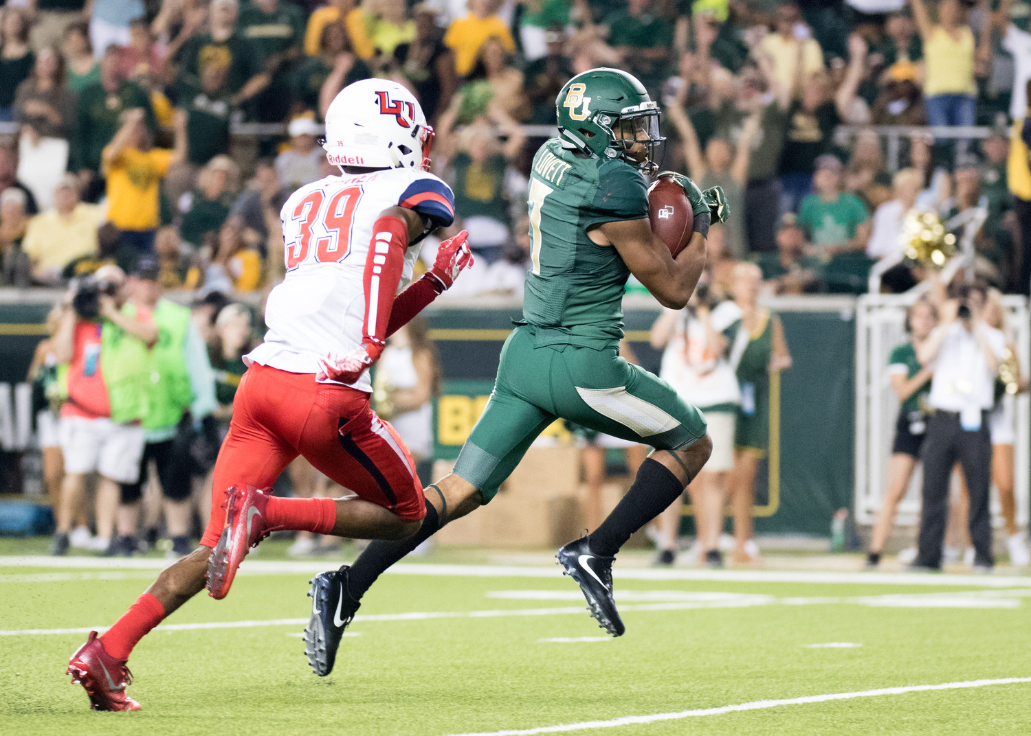 Baylor Bears running back John Lovett (7) runs toward the end zone for a touchdown during the second half of the college football game between the Baylor Bears and the Liberty Flames at McLane Stadium in Waco, Texas. Liberty won 48-45.