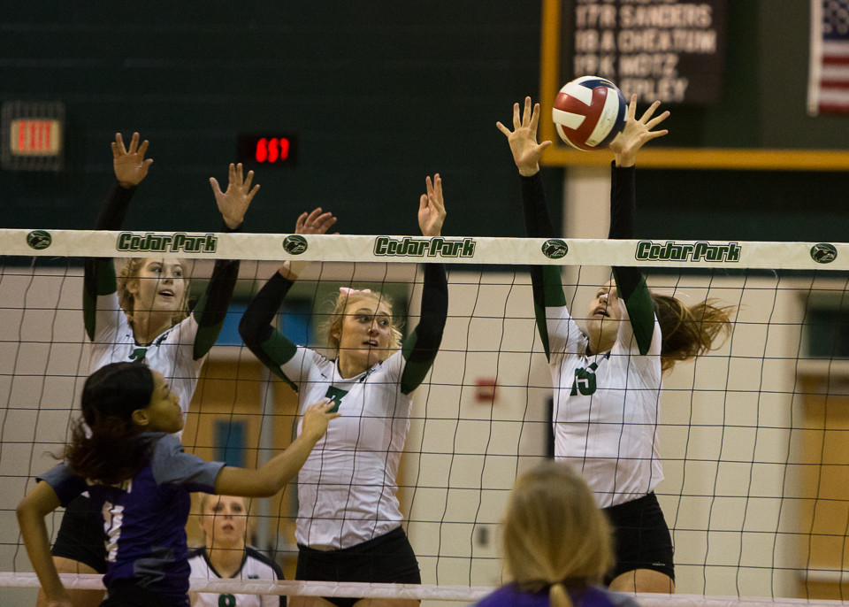 Cedar Park Timberwolves senior Emily Fry (7), senior middle blocker Andrea Grimm (3) and senior Shelby Motz (15) during the high school volleyball game between Cedar Park and Elgin at Cedar Park High School in Cedar Park, Texas, on October 3, 2017.