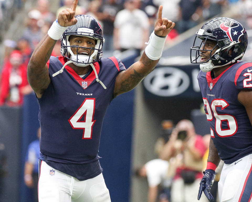 Houston Texans quarterback Deshaun Watson (4) and running back Lamar Miller (26) celebrate a touchdown during the second quarter of an NFL game between the Houston Texans and the Tennessee Titans at NRG Stadium in Houston, Texas.