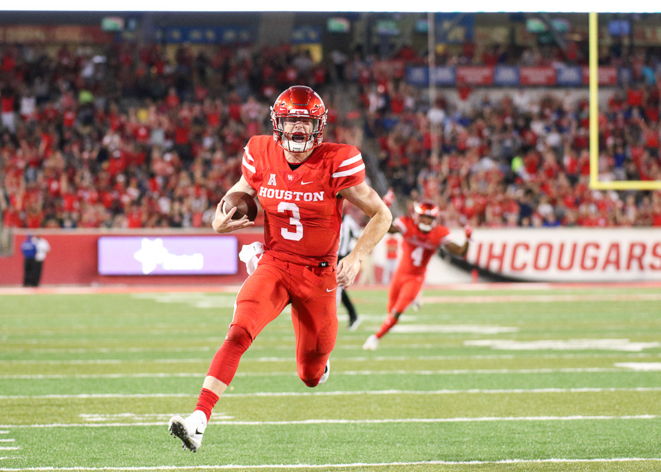 Houston Cougars quarterback Kyle Postma (3) scores on a  22-yard touchdown reception from wide receiver D'Eriq King during the second quarter of an NCAA football game between the Houston Cougars and the SMU Mustangs at TDECU Stadium in Houston, Texas.