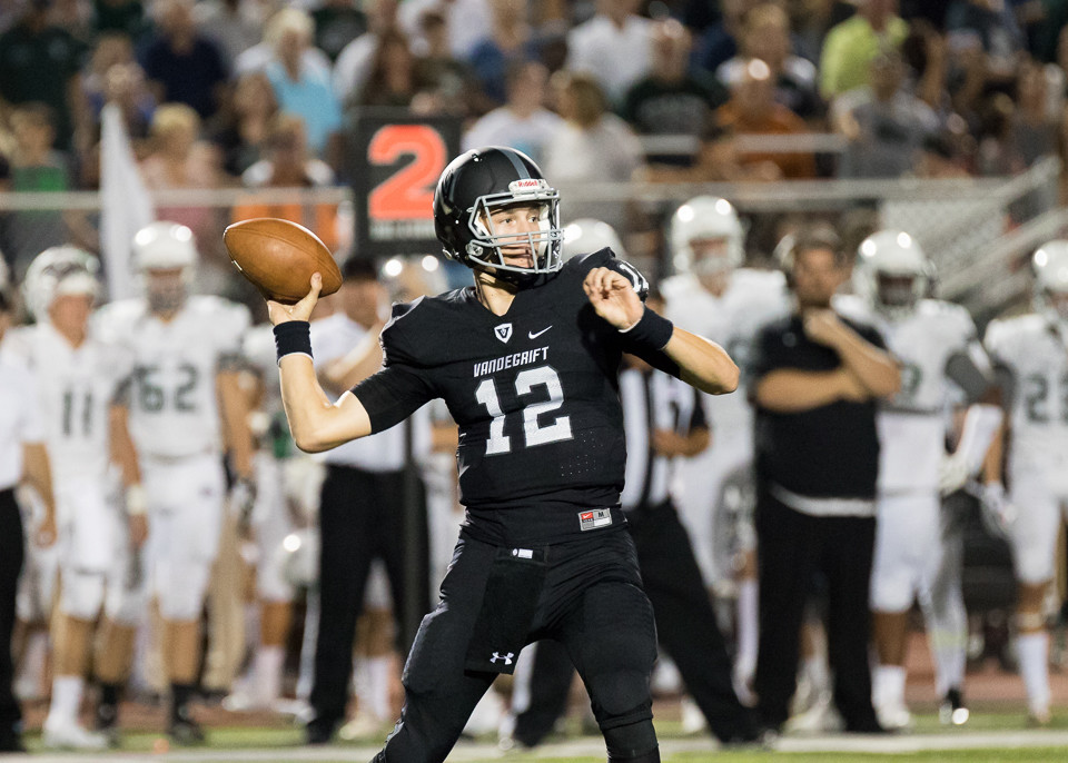 Vandegrift quarterback Justin Moore went 11-for-15 for 198 yards and three touchdowns in Friday's 62-7 win over Lehman.