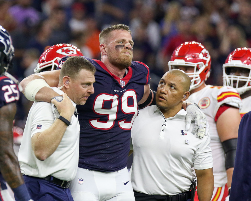 Houston Texans defensive end J.J. Watt (99) leaves the field with an injury during the first quarter of an NFL game between the Houston Texans and the Kansas City Chiefs at NRG Stadium in Houston, Texas. Watt later left the stadium in an ambulance.