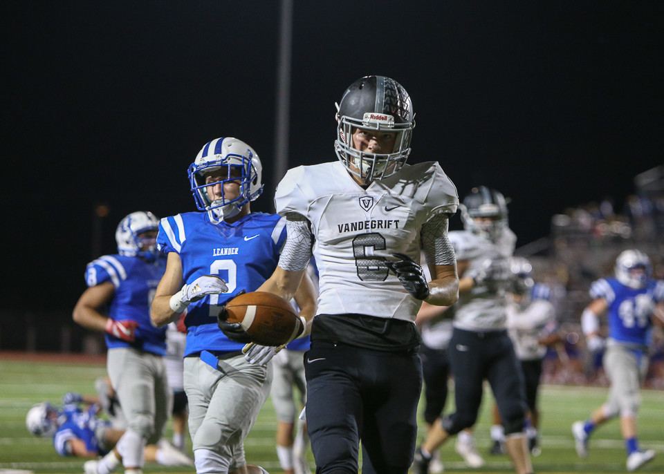 Vandegrift Vipers senior wide receiver Peyton Ausley (6) crosses into the end zone to score a touchdown on a reception during a high school football game between the Leander Lions and the Vandegrift Vipers at Bible Stadium in Leander, Texas, on October 13, 2017.