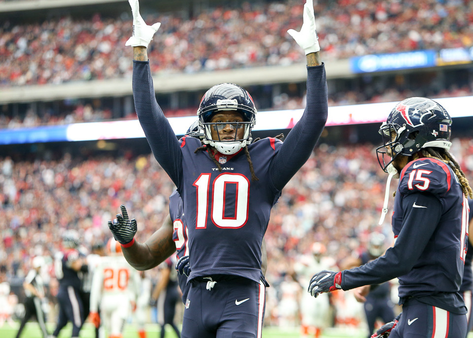 Houston Texans wide receiver DeAndre Hopkins (10) celebrates after scoring a touchdown during the third quarter of an NFL game between the Houston Texans and the Cleveland Browns at NRG Stadium in Houston, Texas.