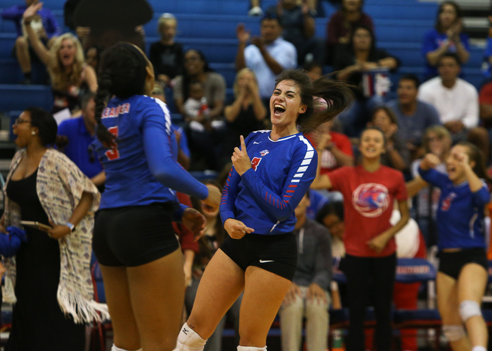 The Leander Lions celebrate winning the first two sets over the Lake Travis Cavaliers during a high school volleyball game at Leander High School in Leander, Texas, on October 17, 2017.
