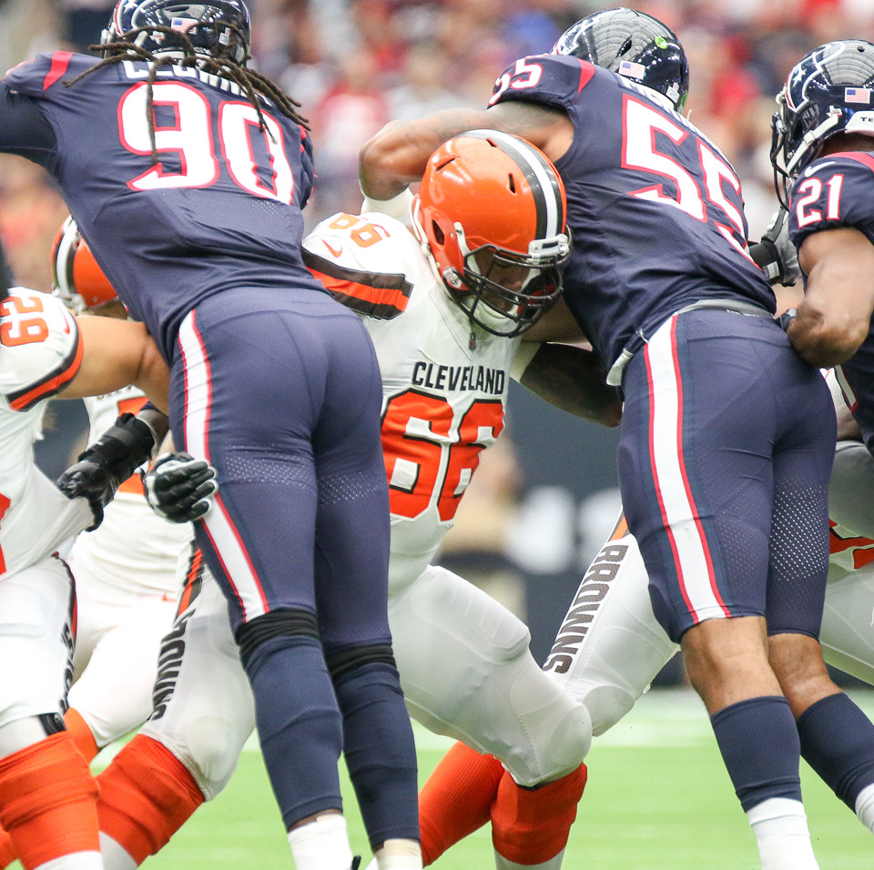 Cleveland Browns offensive guard Spencer Drango (66) blocks both Houston Texans outside linebacker Jadeveon Clowney (90) and inside linebacker Benardrick McKinney (55) on a field goal attempt during the first quarter of an NFL game between the Houston Texans and the Cleveland Browns at NRG Stadium in Houston, Texas.