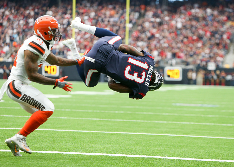 Houston Texans wide receiver Braxton Miller (13) leaps into the end zone for a touchdown during the second quarter of an NFL game between the Houston Texans and the Cleveland Browns at NRG Stadium in Houston, Texas.