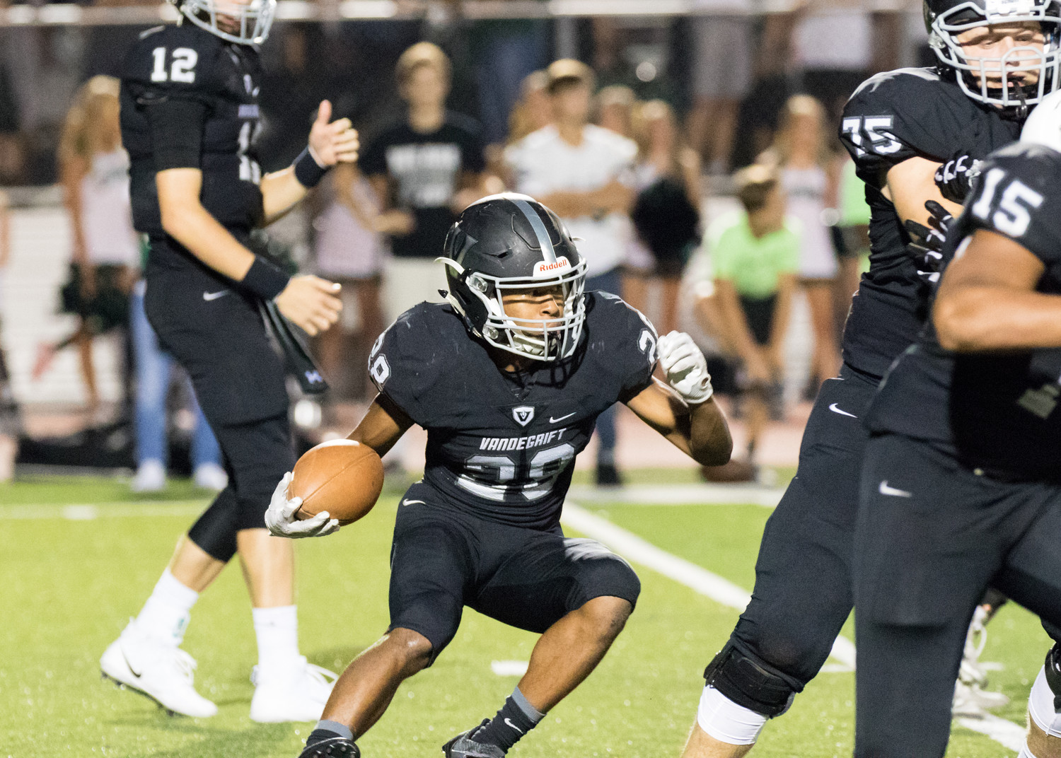 Vandegrift Vipers senior running back Mack Brown (28) gets low on a running play during a high school football game between Vandegrift and Cedar Park at Monroe Stadium in Austin, Texas on Friday, September 8, 2017.