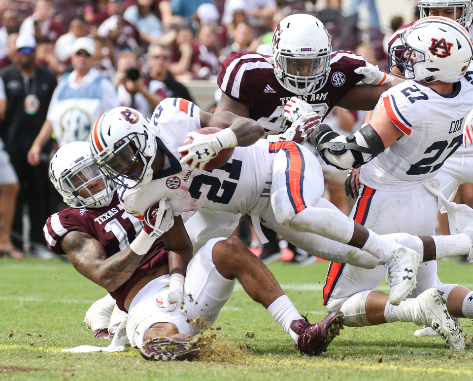 Auburn Tigers running back Kerryon Johnson (21) carries the ball into the end zone for a touchdown during the third quarter of an NCAA college football game between the Texas A&M Aggies and the Auburn Tigers at Kyle Field in College Station, Texas.