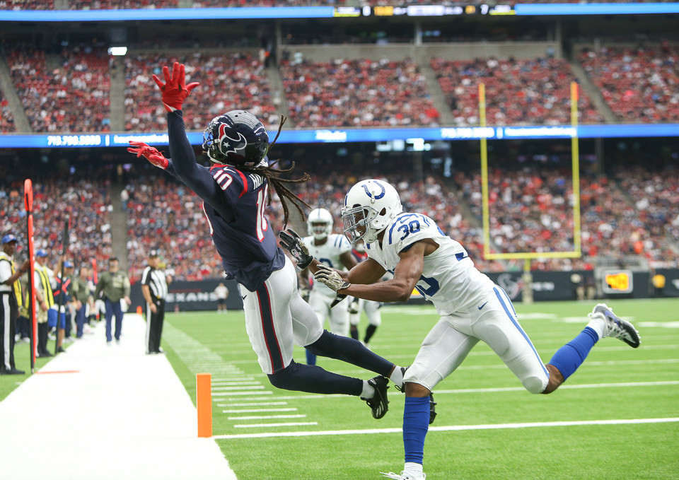 Houston Texans wide receiver DeAndre Hopkins (10) leaps for a pass thrown out of the corner of the end zone with Indianapolis Colts cornerback Rashaan Melvin (30) defending during the first quarter of an NFL football game between the Houston Texans and the Indianapolis Colts at NRG Stadium in Houston, Texas.