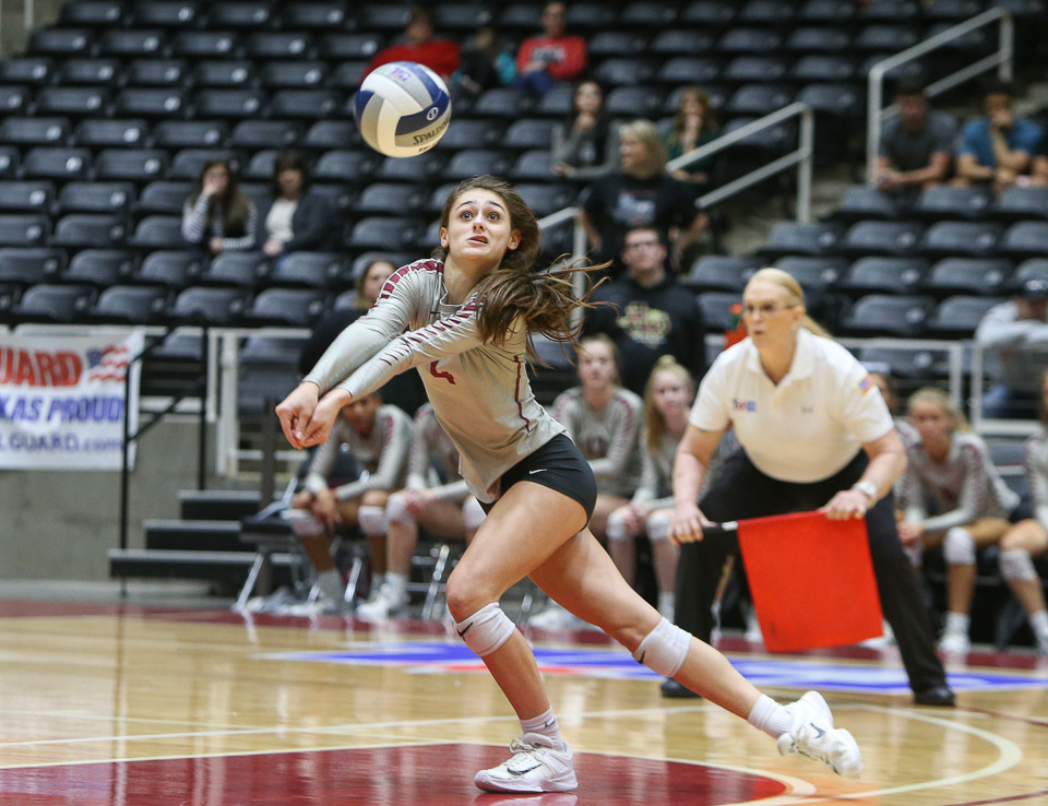 Rouse Raiders sophomore Grayson Schirpik (4) digs the ball during a Class 5A girls high school semifinal volleyball game between Rouse High School and Aledo High School at Curtis Culwell Center in Garland, Texas, on November 17, 2017. Rouse swept Aledo (25-17, 27-25, 25-18) to advance to the finals.