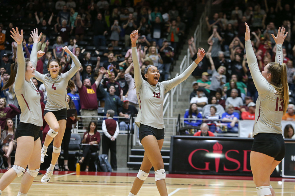 The Rouse Raiders celebrate after beating Aledo High School in straight sets (25-17, 27-25, 25-18) to advance to the Class 5A state volleyball finals at Curtis Culwell Center in Garland, Texas, on November 17, 2017.