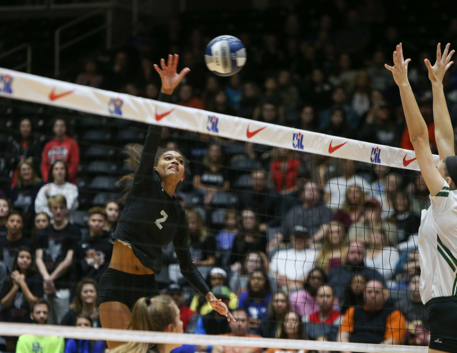 Rouse Raiders senior e'lan McCall (2) attacks during the Class 5A high school volleyball state final between Rouse High School and Prosper High School at Curtis Culwell Center in Garland, Texas, on November 18, 2017. Prosper won the match in five sets, (25-18, 21-25, 18-25, 25, 23, 16-14) to win the 5A state championship.