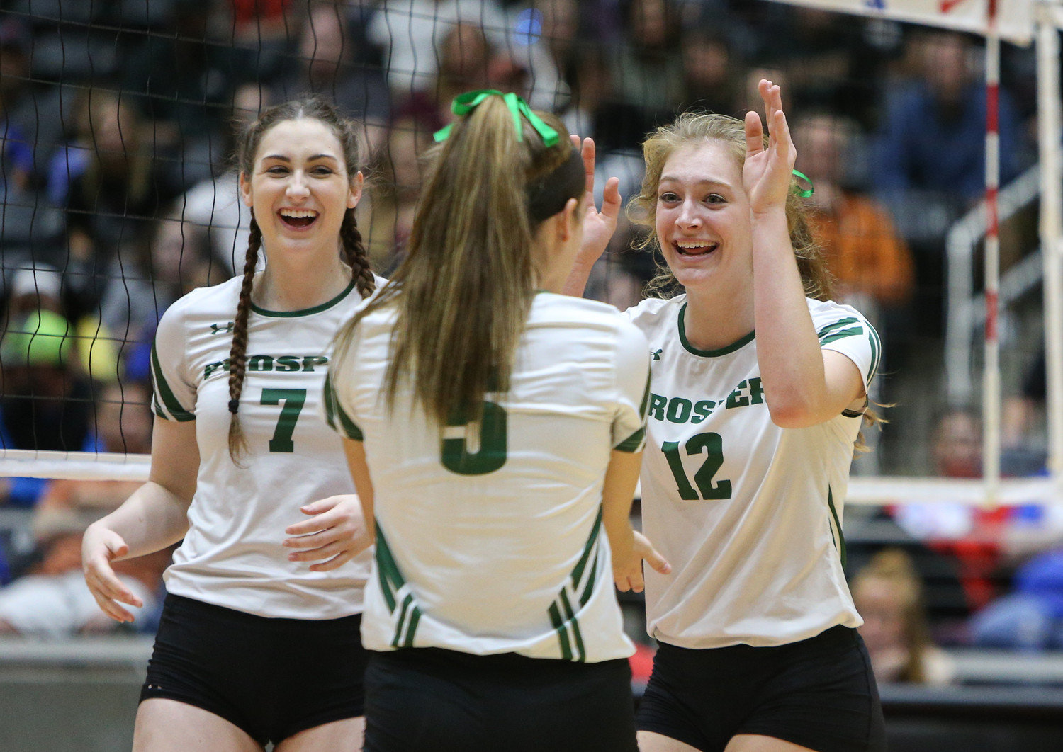 The Prosper Eagles celebrate a point during the Class 5A high school volleyball state final between Rouse High School and Prosper High School at Curtis Culwell Center in Garland, Texas, on November 18, 2017. Prosper won the match in five sets, (25-18, 21-25, 18-25, 25, 23, 16-14) to win the 5A state championship.