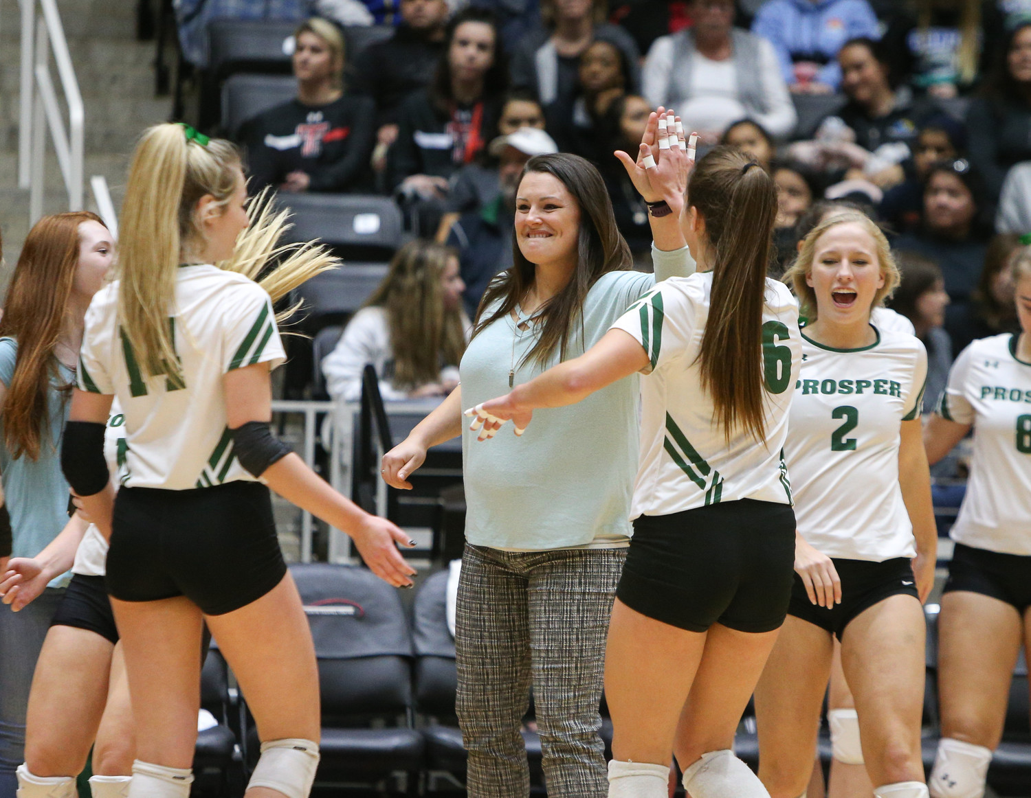 Prosper Eagles head coach Erin Kauffman celebrates a point with her team during the Class 5A high school volleyball state final between Rouse High School and Prosper High School at Curtis Culwell Center in Garland, Texas, on November 18, 2017. Prosper won the match in five sets, (25-18, 21-25, 18-25, 25, 23, 16-14) to win the 5A state championship.