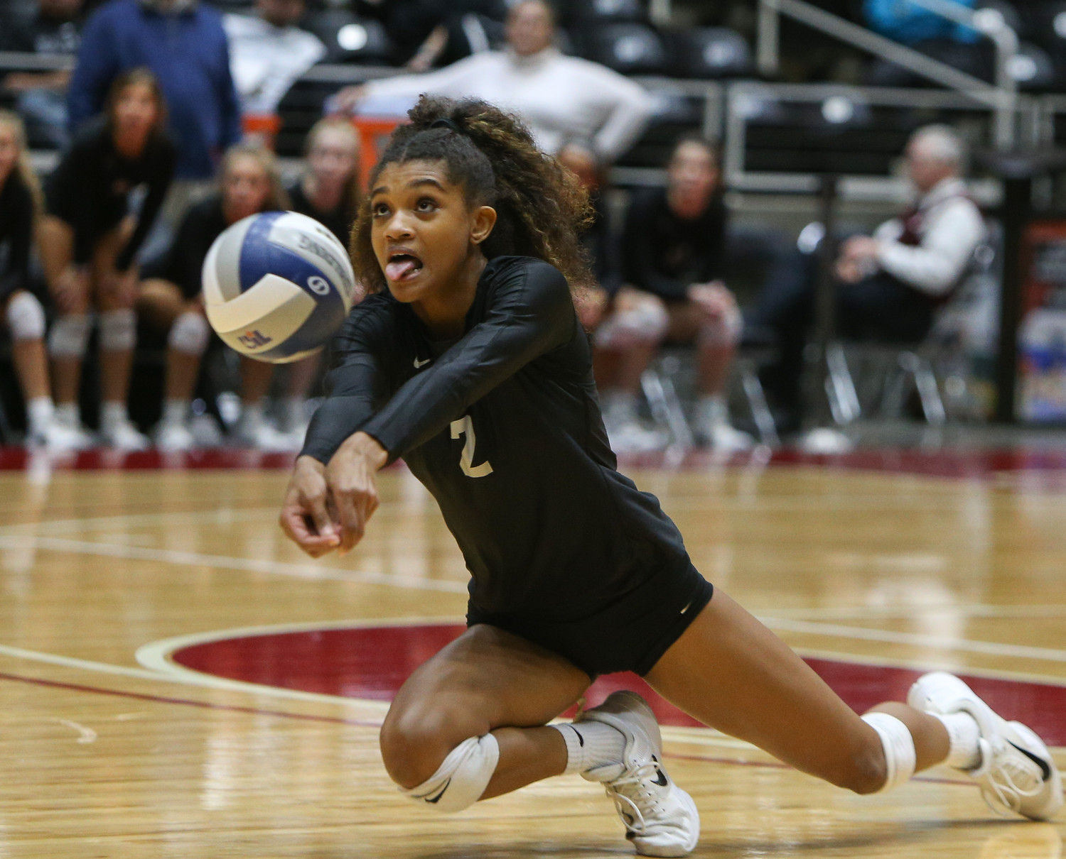 Rouse Raiders senior e'lan McCall (2) digs the ball during the Class 5A high school volleyball state final between Rouse High School and Prosper High School at Curtis Culwell Center in Garland, Texas, on November 18, 2017. Prosper won the match in five sets, (25-18, 21-25, 18-25, 25, 23, 16-14) to win the 5A state championship.
