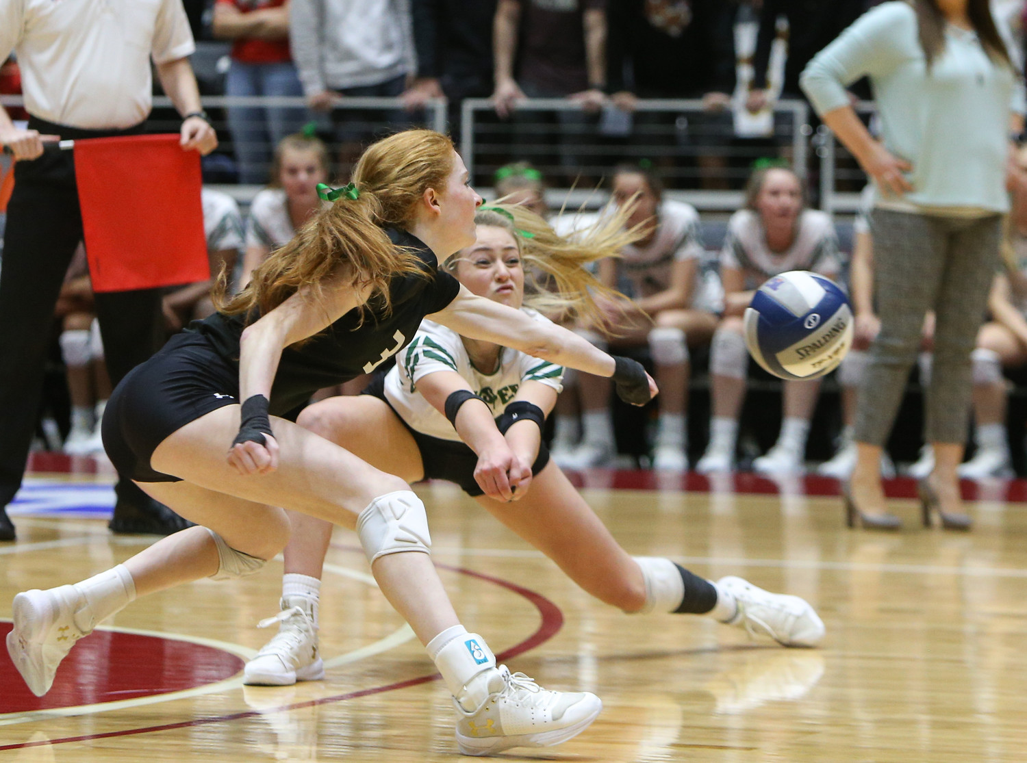 Prosper Eagles junior Kayla Martin (3) and junior Ciera Hecht (14) attempt to dig the ball during the Class 5A high school volleyball state final between Rouse High School and Prosper High School at Curtis Culwell Center in Garland, Texas, on November 18, 2017. Prosper won the match in five sets, (25-18, 21-25, 18-25, 25, 23, 16-14) to win the 5A state championship.