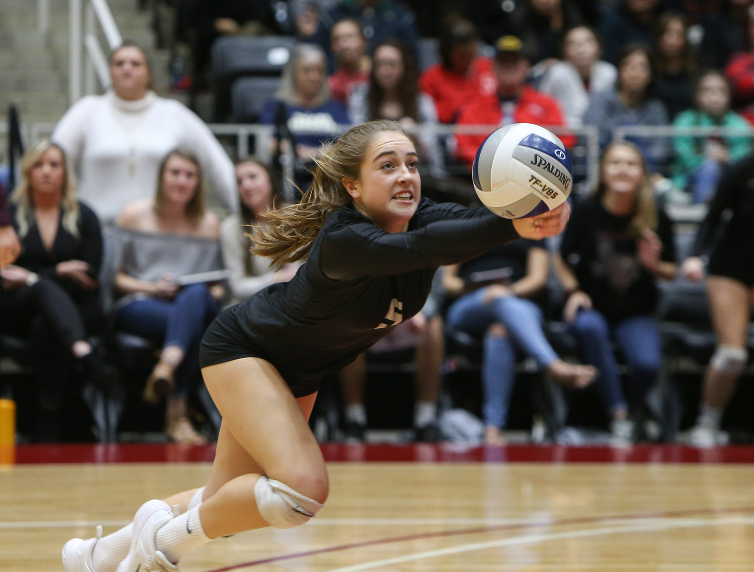Rouse Raiders sophomore Reilly Heinrich (5) digs the ball during the Class 5A high school volleyball state final between Rouse High School and Prosper High School at Curtis Culwell Center in Garland, Texas, on November 18, 2017. Prosper won the match in five sets, (25-18, 21-25, 18-25, 25, 23, 16-14) to win the 5A state championship.
