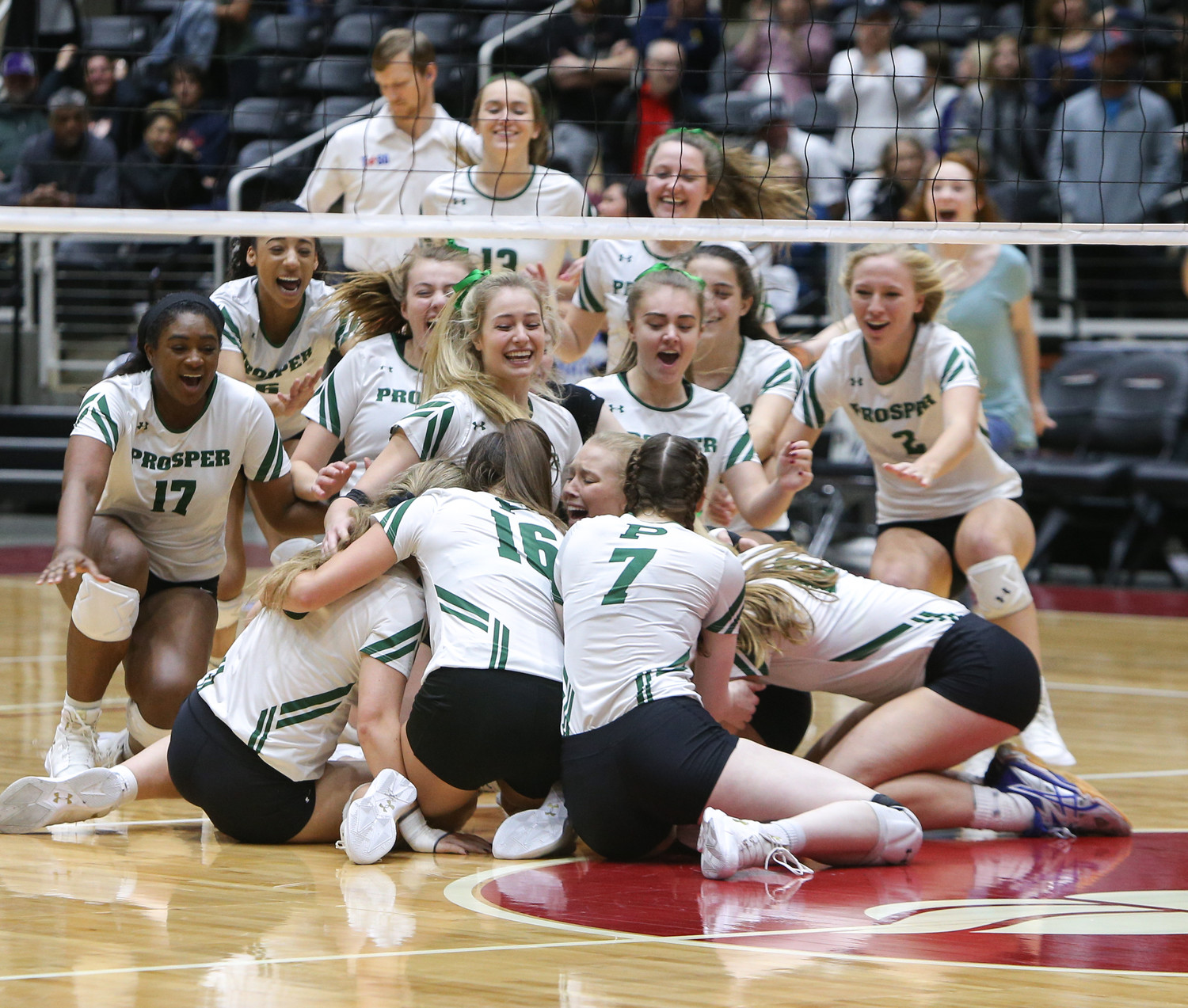 The Prosper Eagles celebrate after winning the Class 5A state volleyball title in five sets (25-18, 21-25, 18-25, 25, 23, 16-14) over Rouse High School at Curtis Culwell Center in Garland, Texas, on November 18, 2017.