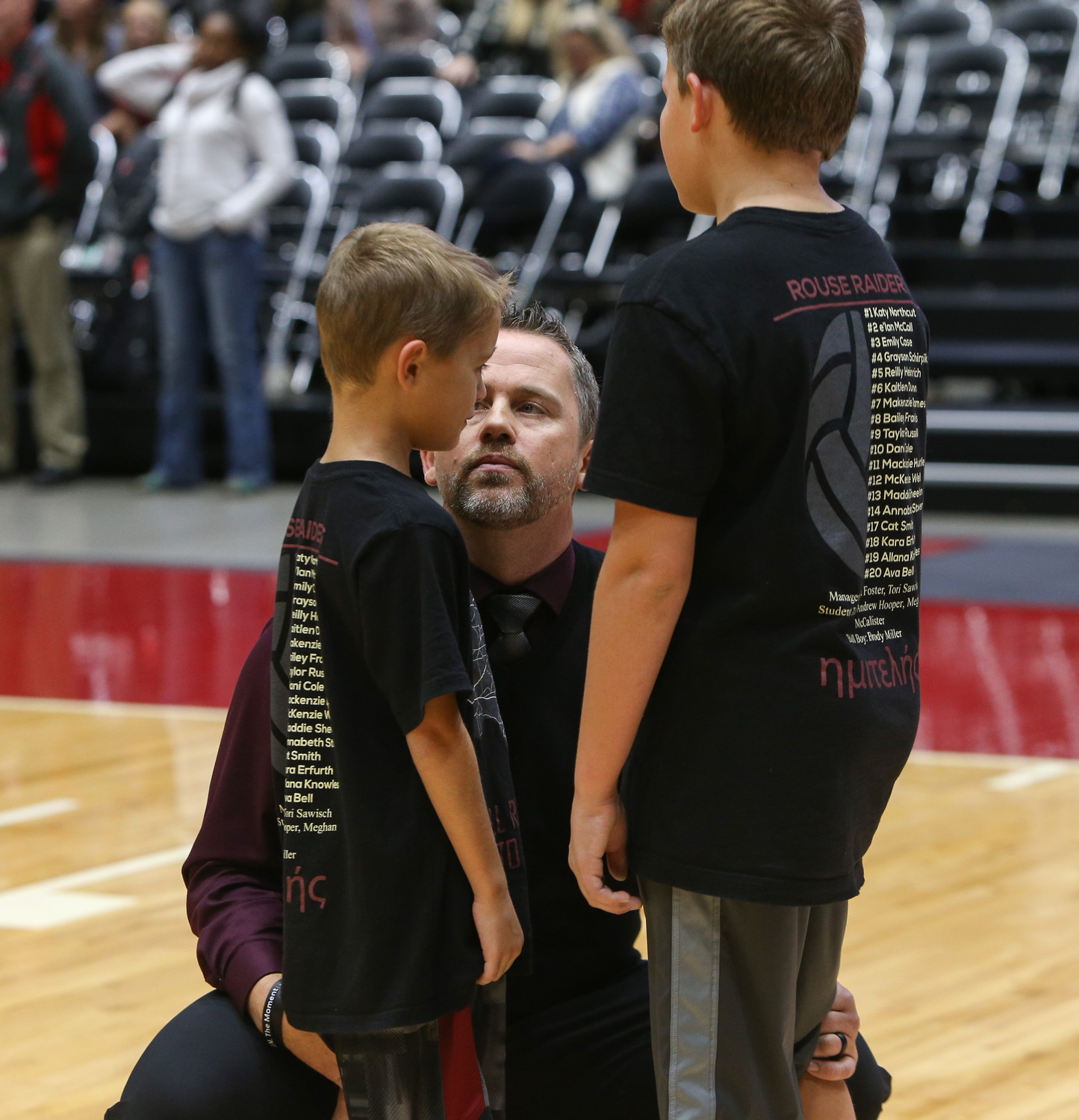 Rouse head coach Jacob Thompson talks to his children after the Raiders lost the Class 5A high school volleyball state final to Prosper High School at Curtis Culwell Center in Garland, Texas, on November 18, 2017. Prosper won the match in five sets, (25-18, 21-25, 18-25, 25, 23, 16-14) to win the 5A state championship.