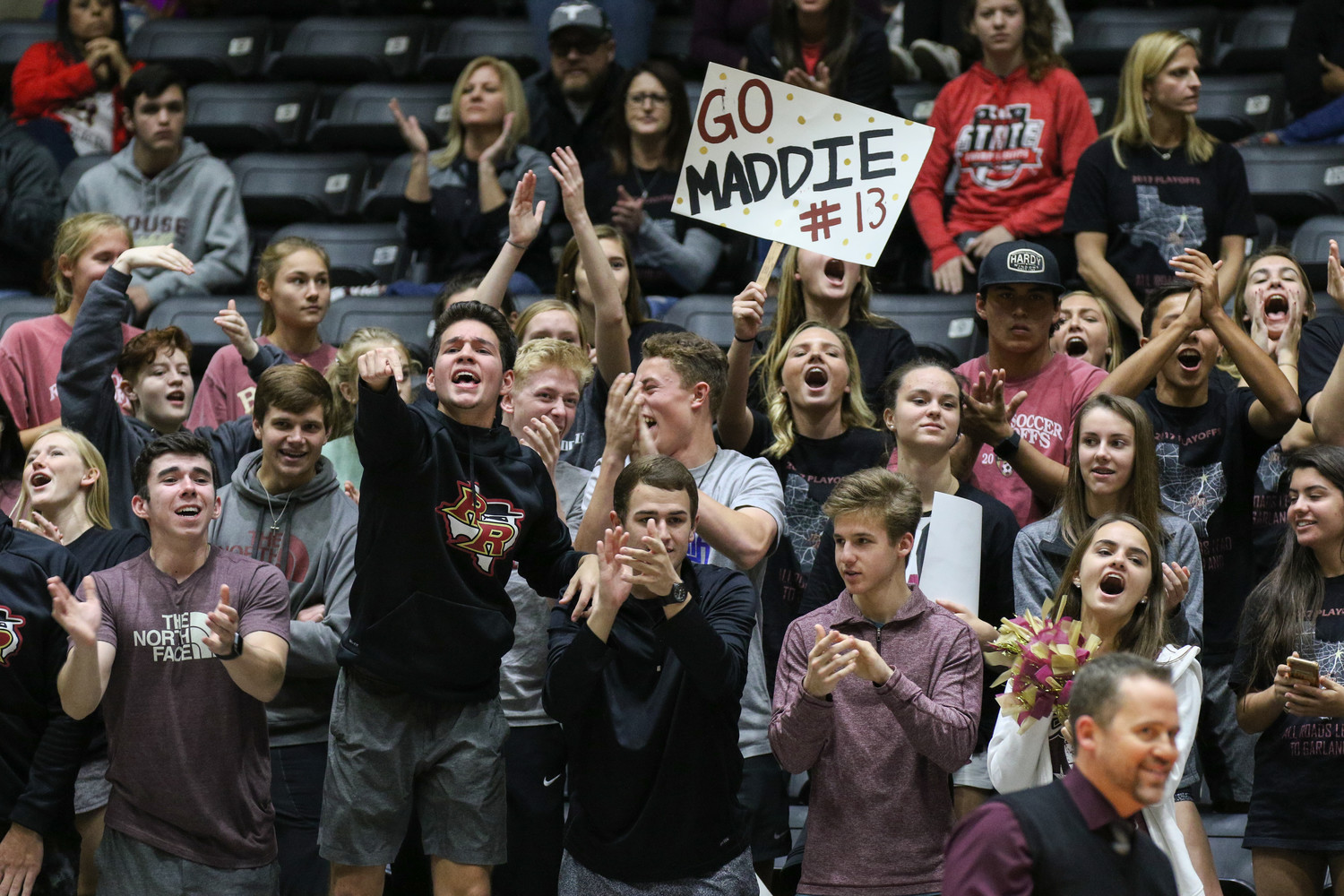 The Rouse crowd cheers during the Class 5A high school volleyball state final between Rouse High School and Prosper High School at Curtis Culwell Center in Garland, Texas, on November 18, 2017. Prosper won the match in five sets, (25-18, 21-25, 18-25, 25, 23, 16-14) to win the 5A state championship.