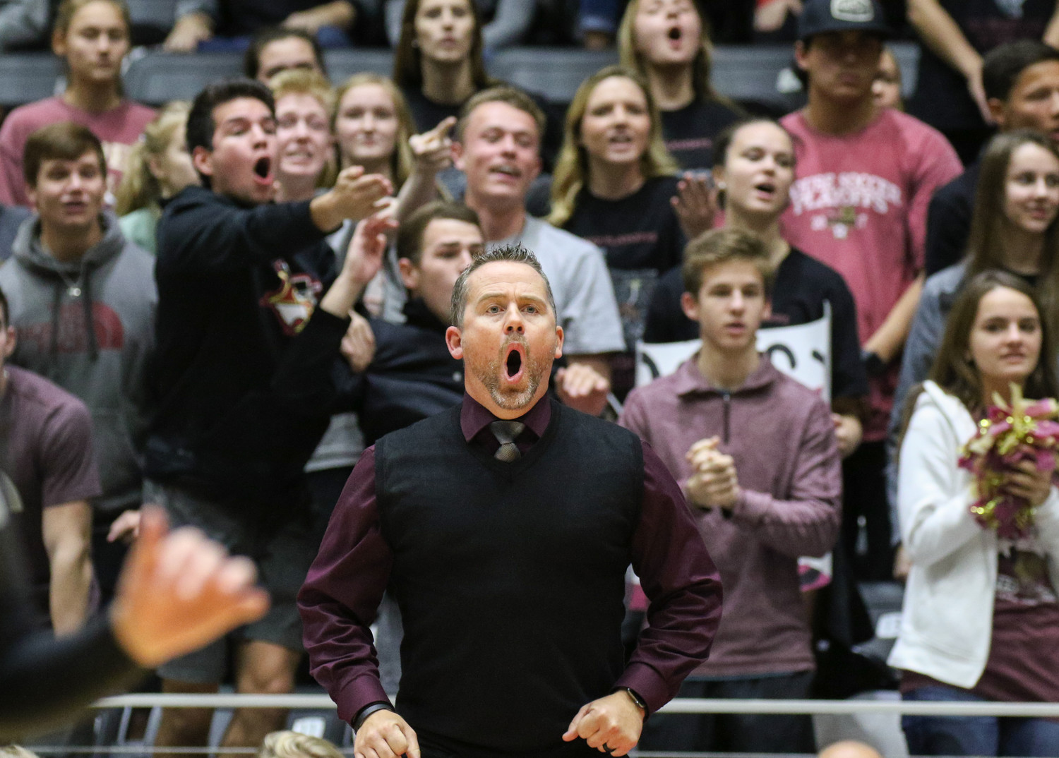 Rouse Raiders head coach Jacob Thompson and the Rouse crowd react to a call during the Class 5A high school volleyball state final between Rouse High School and Prosper High School at Curtis Culwell Center in Garland, Texas, on November 18, 2017. Prosper won the match in five sets, (25-18, 21-25, 18-25, 25, 23, 16-14) to win the 5A state championship.