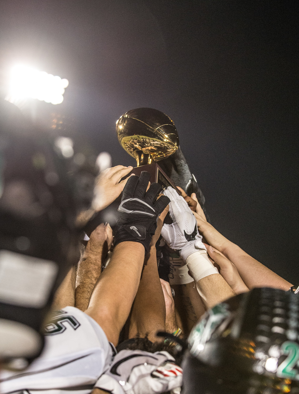 The Cedar Park Timberwolves hold the bi-district trophy after beating Magnolia 24-20 on Nov. 17, 2017.