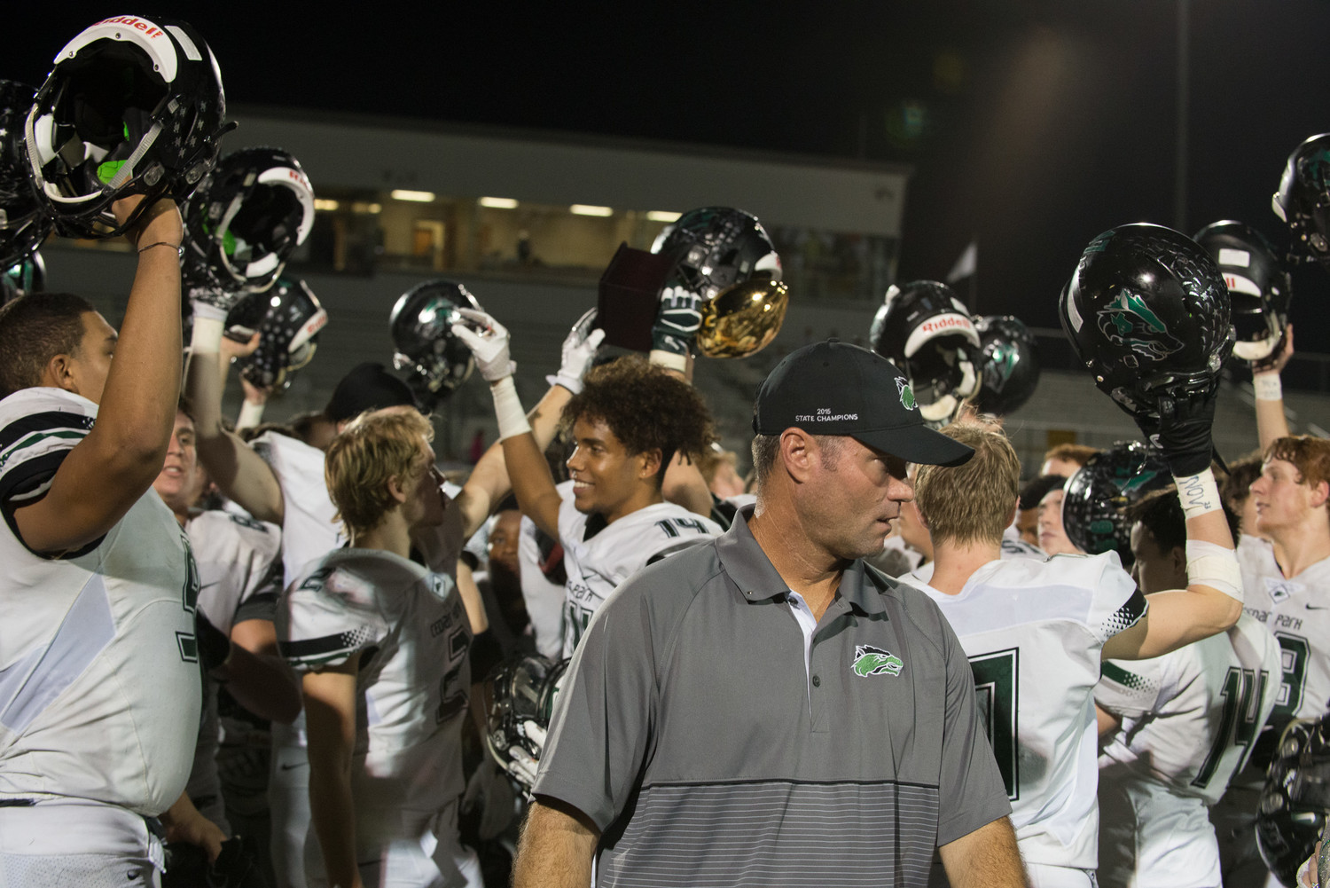 Cedar Park Timberwolves coach Carl Abseck as his team celebrates a bi-district playoff win over Magnolia on Nov. 17, 2017.