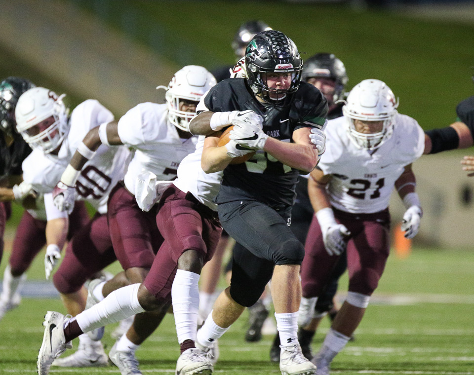 Cedar Park Timberwolves senior Luke Pollicke (34) carries the ball during a high school football playoff game between the Cedar Park Timberwolves and the Ennis Lions at Waco ISD Stadium in Waco, Texas, on November 24, 2017.