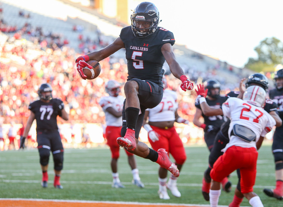Lake Travis Cavaliers wide receiver Garrett Wilson (5) celebrates after scoring a touchdown during the fourth quarter of a high school football playoff game between the Lake Travis Cavaliers and the Judson Rockets at DKR Texas Memorial Stadium in Austin, Texas, on November 25, 2017.