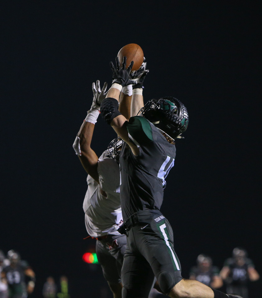 Cedar Park Timberwolves junior Logan Mayou (41) brings in a touchdown pass during a high school football playoff game between the Cedar Park Timberwolves and the Manvel Mavericks at Waller ISD Stadium in Waller, Texas, on December 1, 2017. Manvel won 56-17.