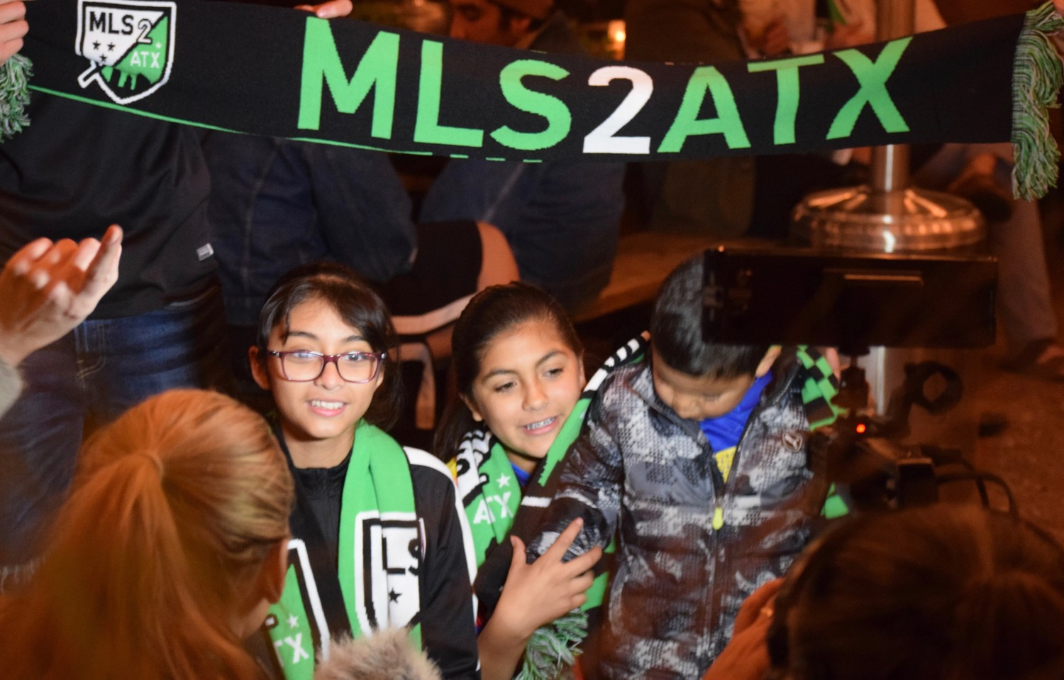 MLS2ATX fans are interviewed at Family Night at Takoba in East Austin on Wednesday.