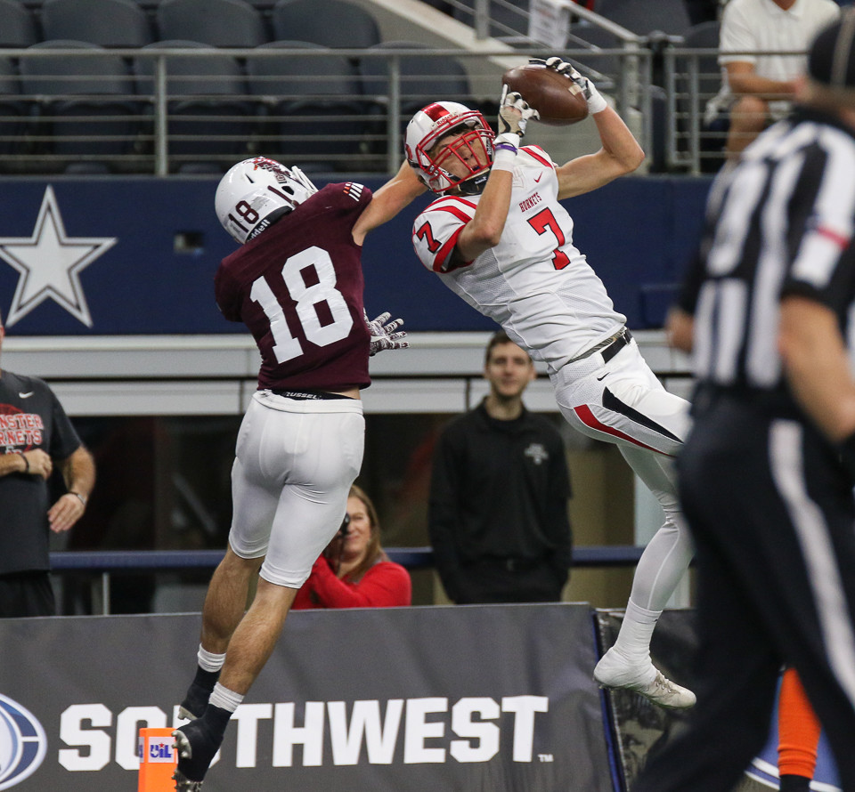 Muenster Hornets sophomore wide receiver Danny Luttmer (7) leaps to bring in a touchdown pass during the first half of the UIL Class 2A Division II state football championship game between Muenster High School and Tenaha High School at AT&T Stadium in Arlington, Texas, on December 21, 2017.