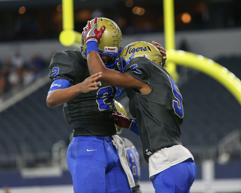 Rockdale Tigers senior Torry Locklin (2) and senior Jaquayln Crawford (5) celebrate a touchdown during the first half of the UIL Class 3A Division I state football championship game between Rockdale High School and Brock High School at AT&T Stadium in Arlington, Texas, on December 21, 2017.