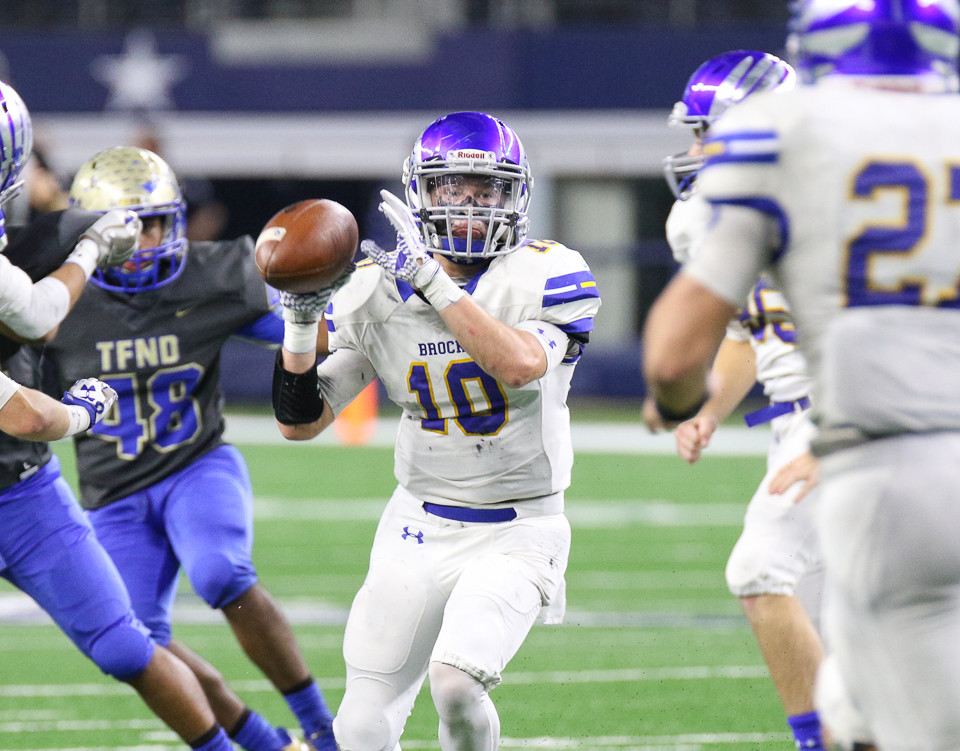 Brock Eagles junior Toby Morrison (10) pitches the ball back to senior Dawson Littlepage (27) on a kickoff return during the UIL Class 3A Division I state football championship game between Rockdale High School and Brock High School at AT&T Stadium in Arlington, Texas, on December 21, 2017.