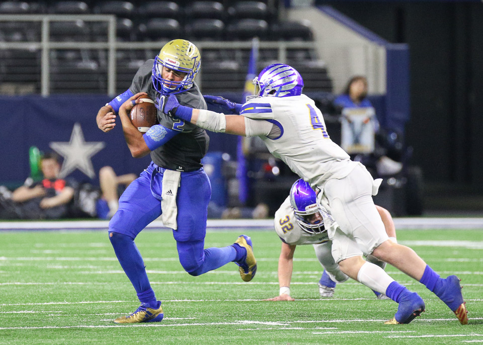 Brock Eagles junior Zakk Young (4) reaches for Rockdale Tigers senior Torry Locklin (2) during the UIL Class 3A Division I state football championship game between Rockdale High School and Brock High School at AT&T Stadium in Arlington, Texas, on December 21, 2017.