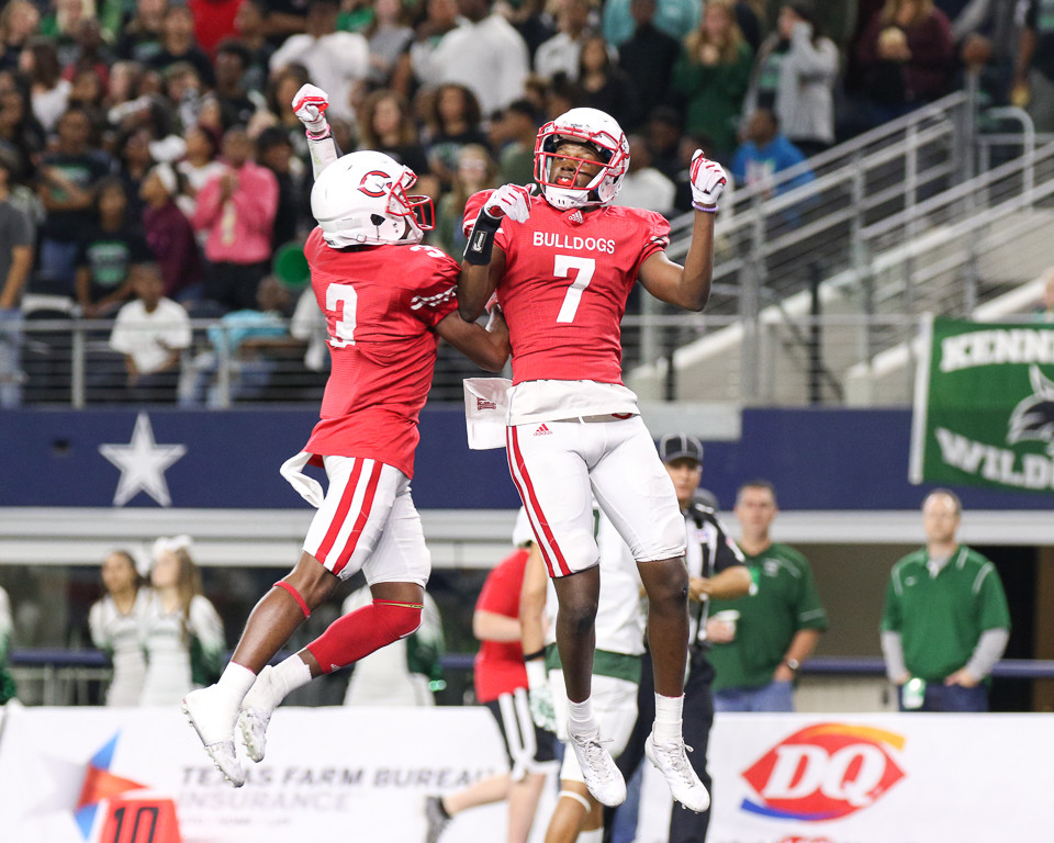 Carthage Bulldogs senior wide receiver Dewaylon Ingram (7) and Carthage Bulldogs senior wide receiver Dee Bowens (3) celebrate a touchdown during the first half of the UIL Class 4A Division I state football championship game between Carthage High School and Kennedale High School at AT&T Stadium in Arlington, Texas, on December 22, 2017.