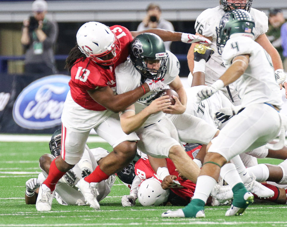 Carthage Bulldogs senior Ahmad Brown (13) sacks Kennedale Wildcats junior quarterback Evan Jowers (2)  during the UIL Class 4A Division I state football championship game between Carthage High School and Kennedale High School at AT&T Stadium in Arlington, Texas, on December 22, 2017.