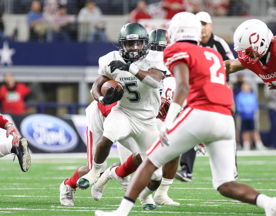 Kennedale Wildcats senior running back Jaden Knowles (5) carries the ball during the UIL Class 4A Division I state football championship game between Carthage High School and Kennedale High School at AT&T Stadium in Arlington, Texas, on December 22, 2017.