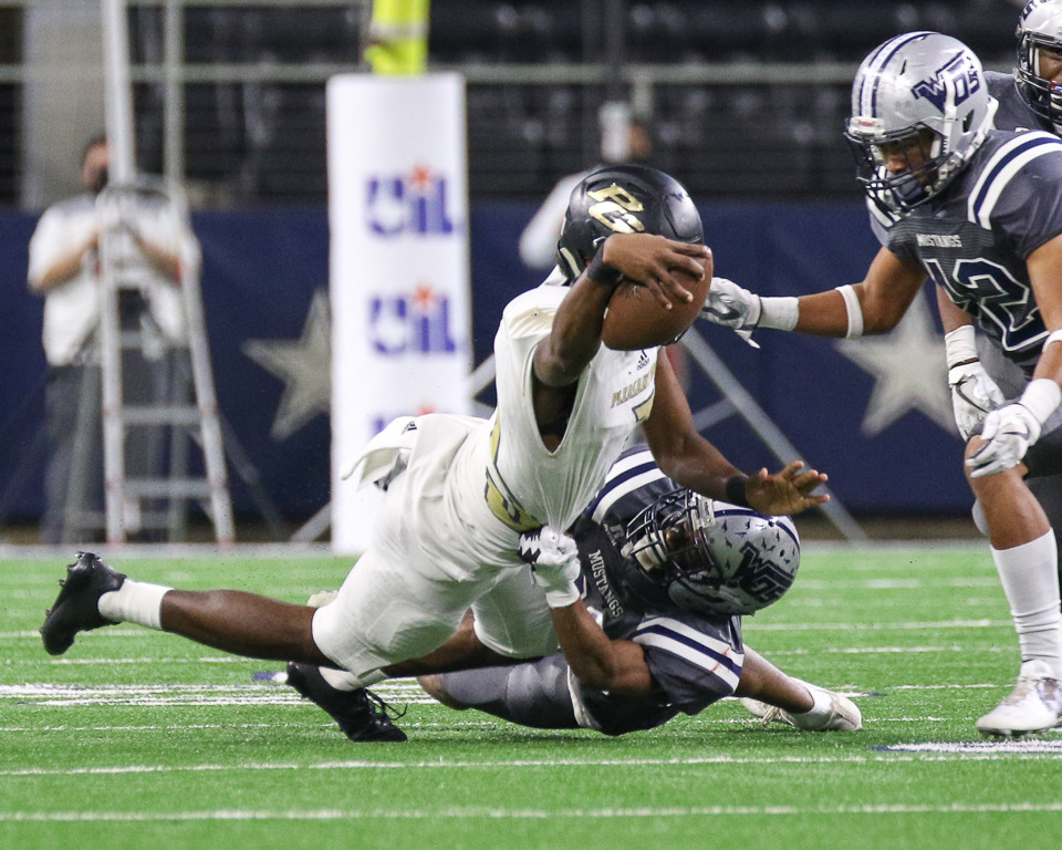 Pleasant Grove Hawks senior TJ Cole (15) dives to extend the ball for a first down during the first quarter of the UIL Class 4A Division II state football championship game between West Orange-Stark High School and Pleasant Grove High School at AT&T Stadium in Arlington, Texas, on December 22, 2017.